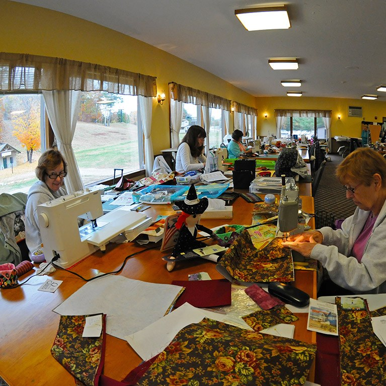 Guests working on quilting projects
